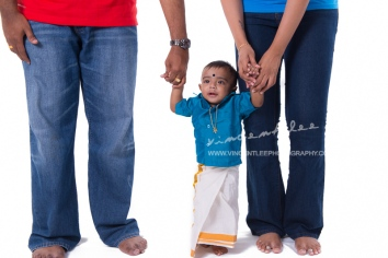 A 7 months old Indian boy wearing his traditional clothing for the 1st time