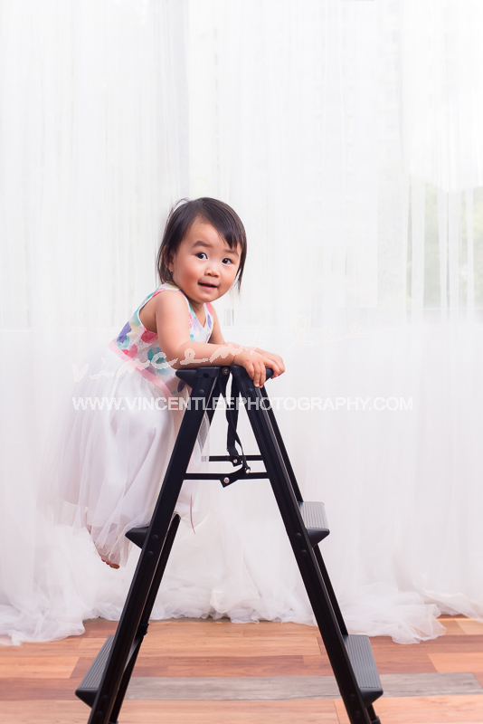 Emily with her favourite ladder and her princess smile