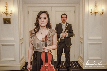Love this photo of both the bride and groom , both musicians.