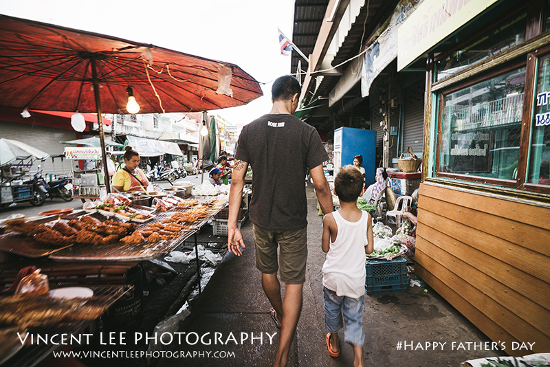 Muay Thai champion boxer with his son to market preparing for dinner